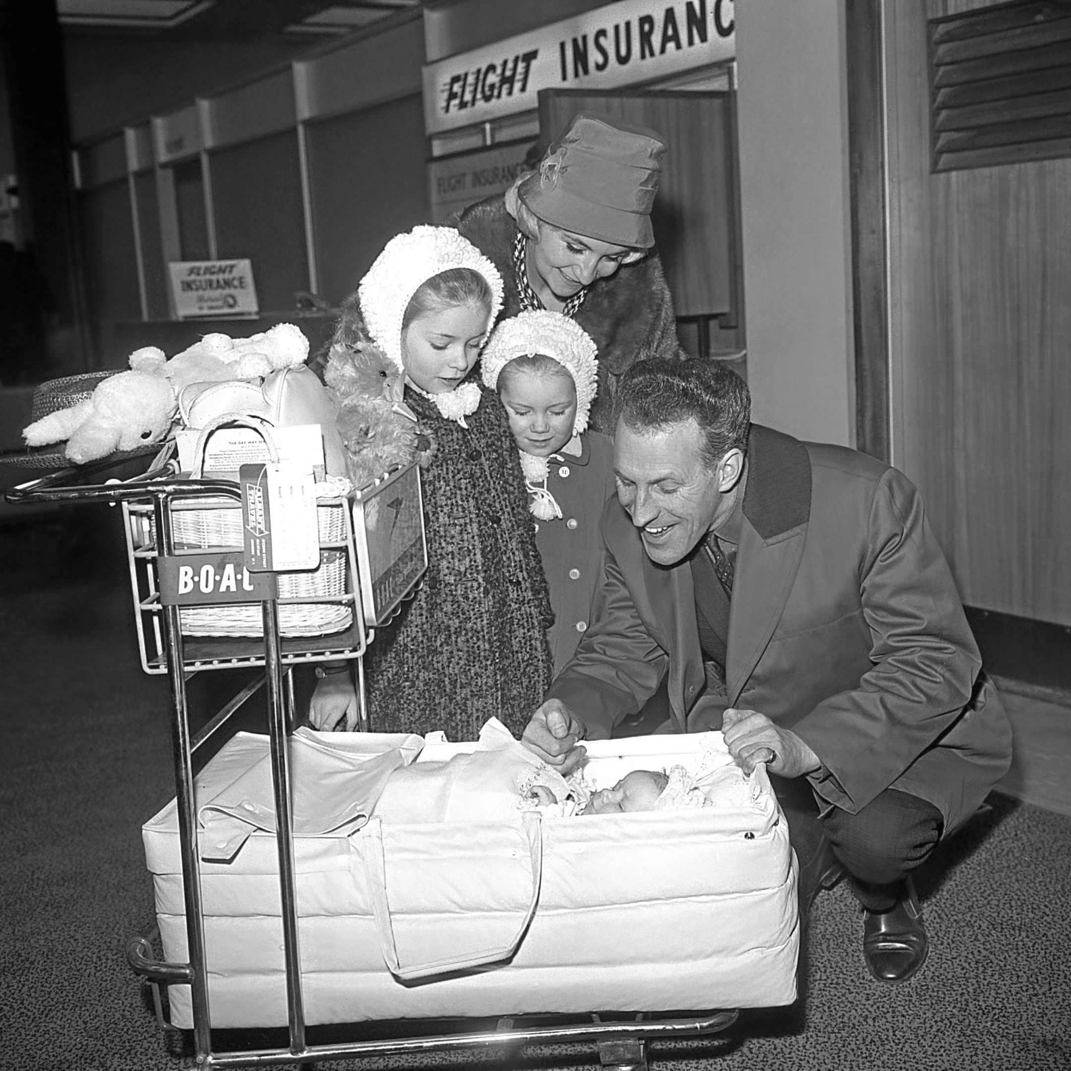 Bruce Forsyth wife his wife Penny and children Debbie, 7, Julie, 4, and 3-month-old Laura. They were leaving for a month's holiday in Barbados.