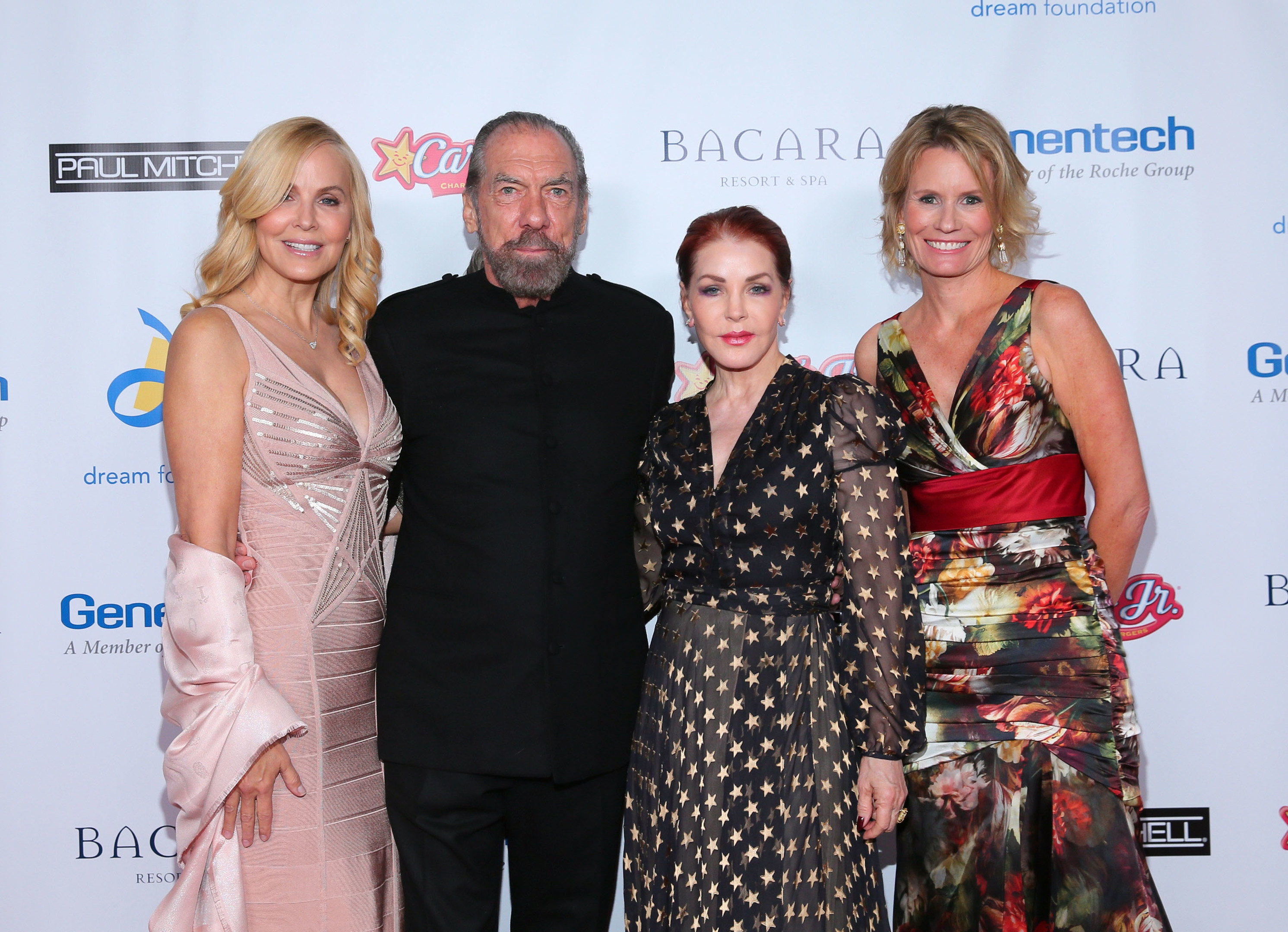 (L-R) Eloise DeJoria, John Paul DeJoria, Priscilla Presley and Kisa Heyer attend the Dream Foundation's 13th annual celebration of dreams gala held at the Bacara Resort and Spa in 2014 (Photo by Mark Davis/Getty Images)