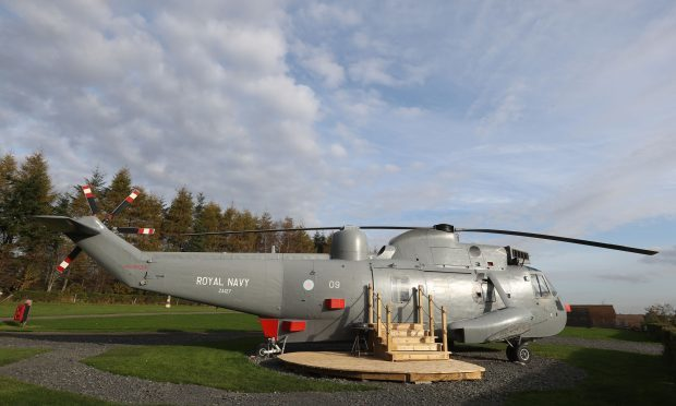 The retired Sea King helicopter which has returned to active service, this time as Scotland's most unusual place to stay, a holiday home at Mains Farm Wigwams (Andrew Milligan/PA)