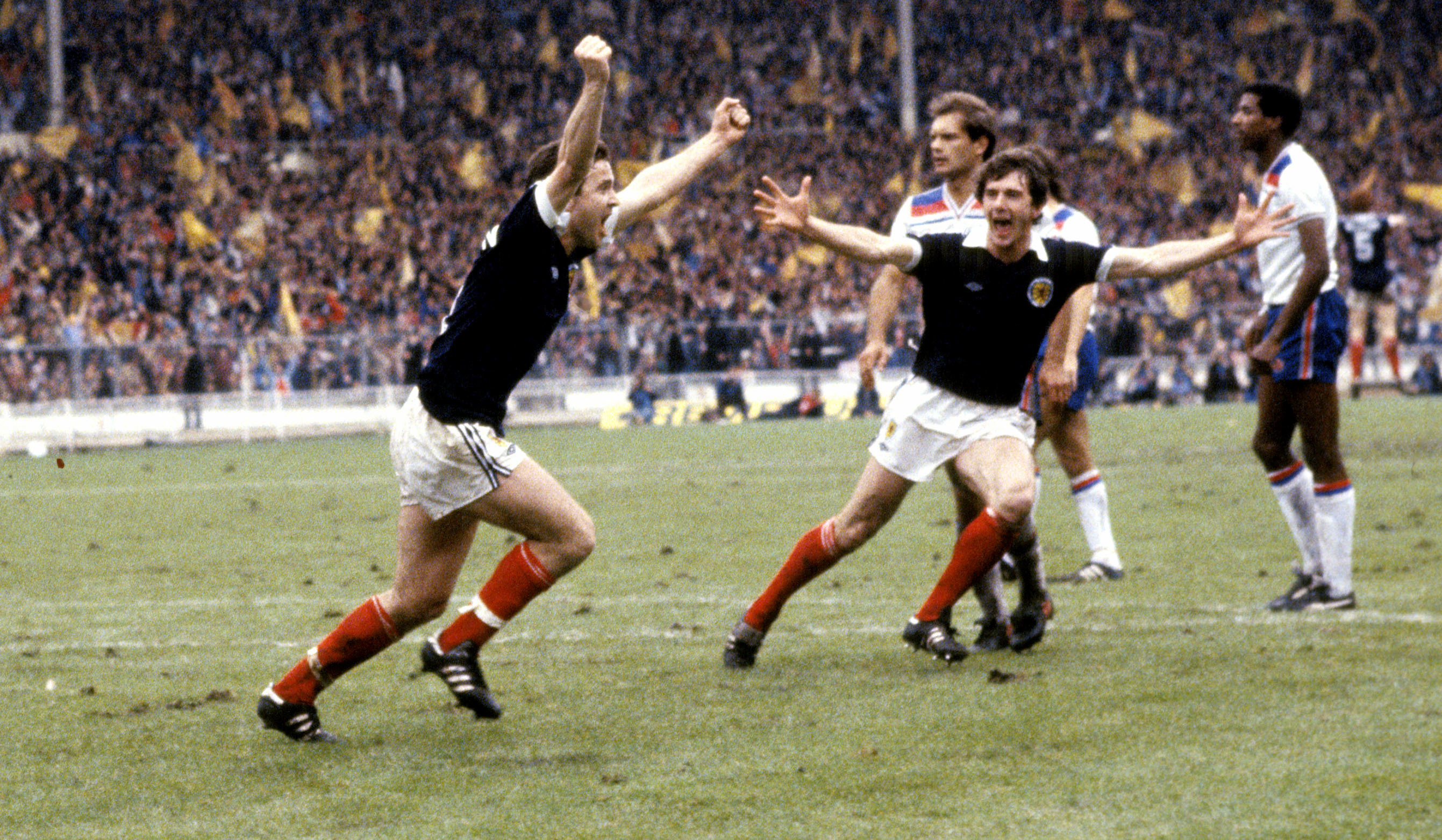 Scotland's John Robertson (left) celebrates his penalty goal with teammate Ray Stewart (SNS Group)