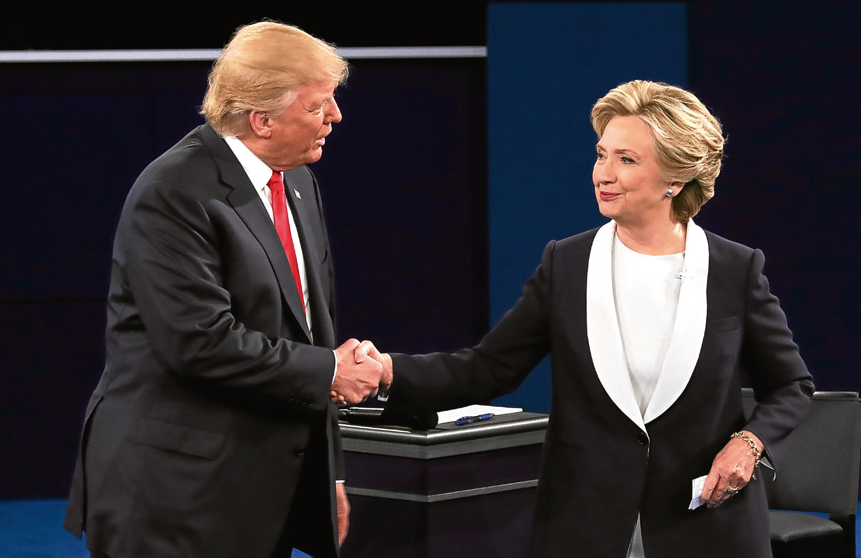 Donald Trump shakes hands with Hillary Clinton (Chip Somodevilla/Getty Images)