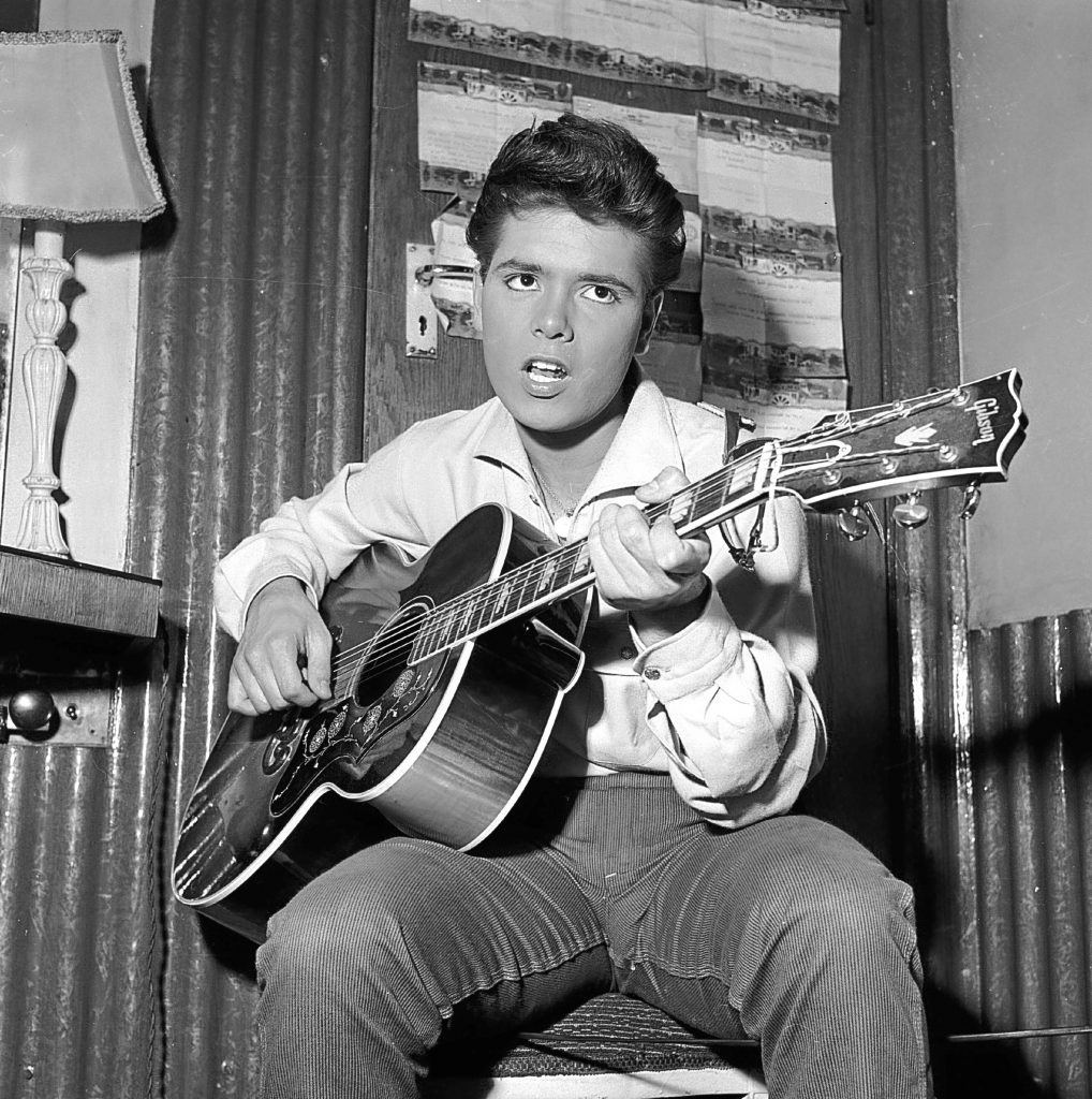 Cliff Richard strums a tune on his trusty guitar before a concert. (John Pratt/Keystone Features/Getty Images)
