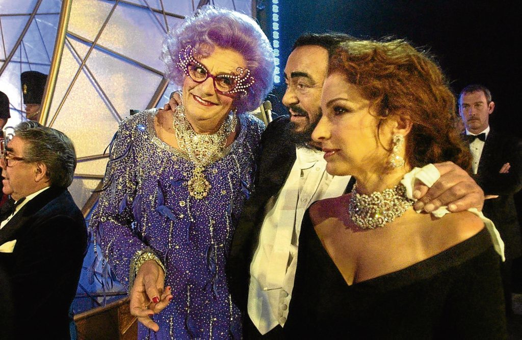 Barry Humphries, aka Dame Edna Everage, with singers Luciano Pavarotti and Gloria Estefan at the Festival Theatre, in Edinburgh, for the start of the 75th Royal Variety performance (David Cheskin / PA)