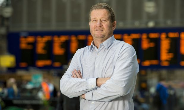 Phil Verster, Managing Director of the Network Rail/Abellio Scotrail alliance, greets customers and staff alike at Glasgow's Central Station (SNS)