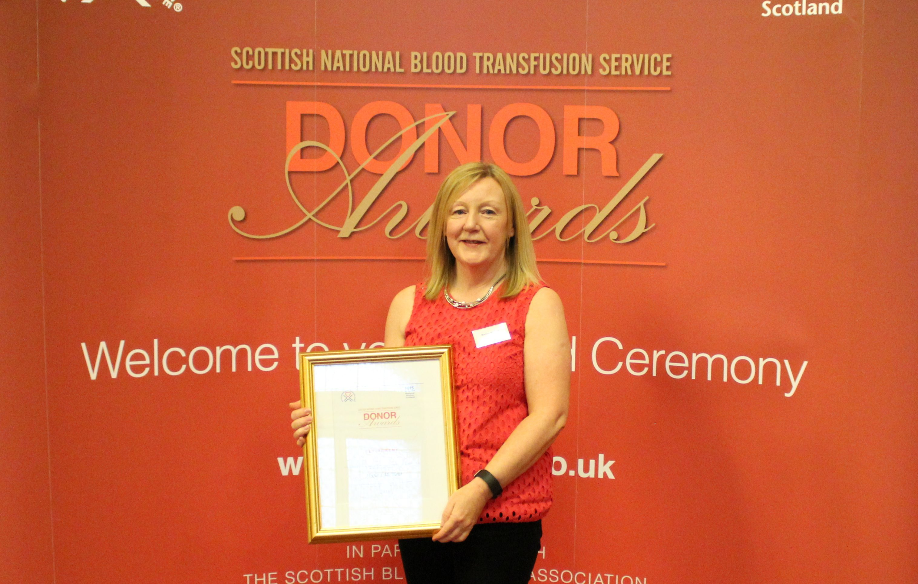 Marion was awarded with her certificate in Glasgow after giving 100 pints of blood