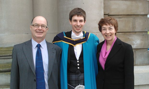 John Jennings with mum Carol and dad Stuart