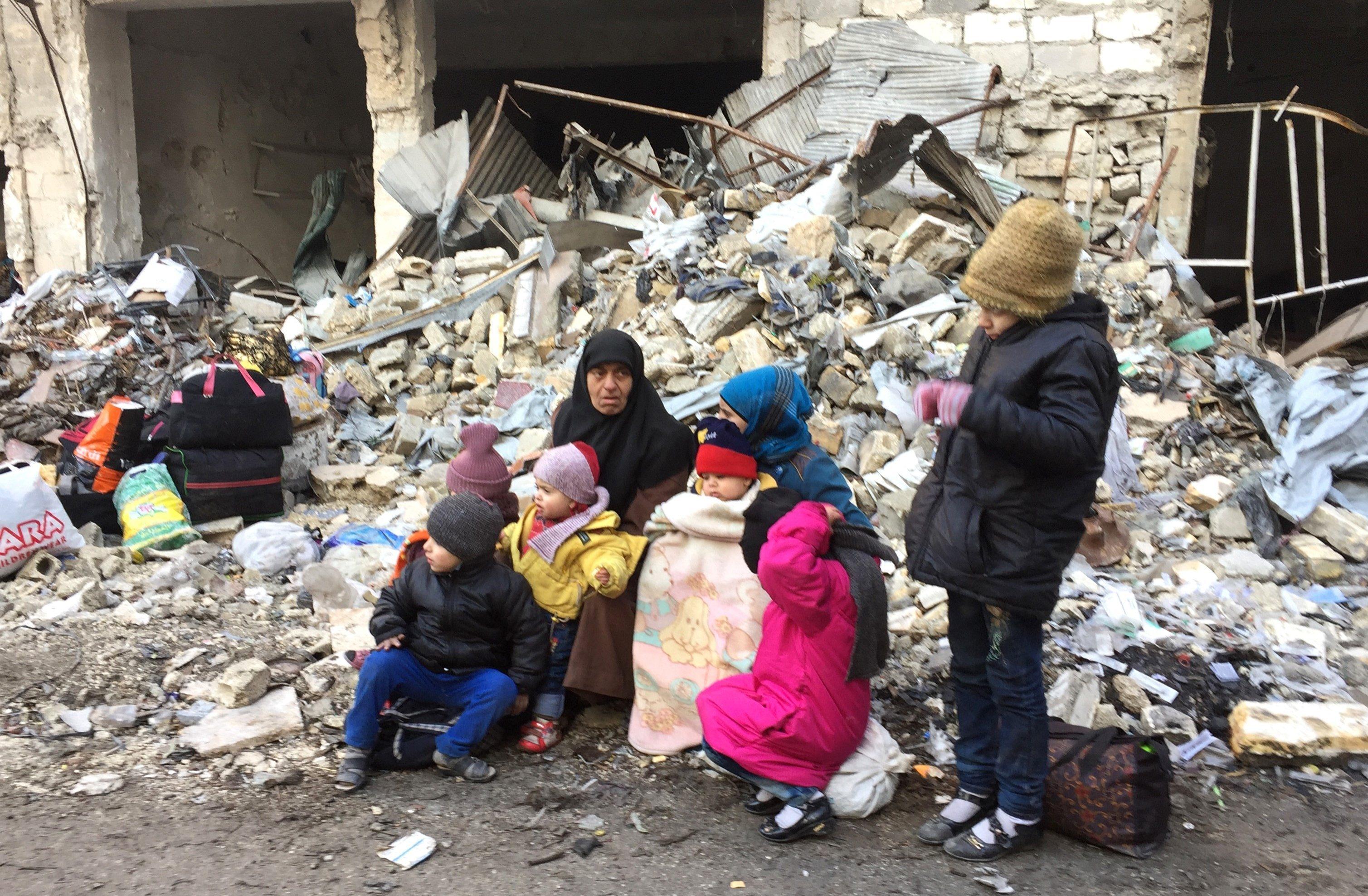 Civilians wait to be evacuated from Aleppo (Mamun Ebu Omer/Anadolu Agency/Getty Images)