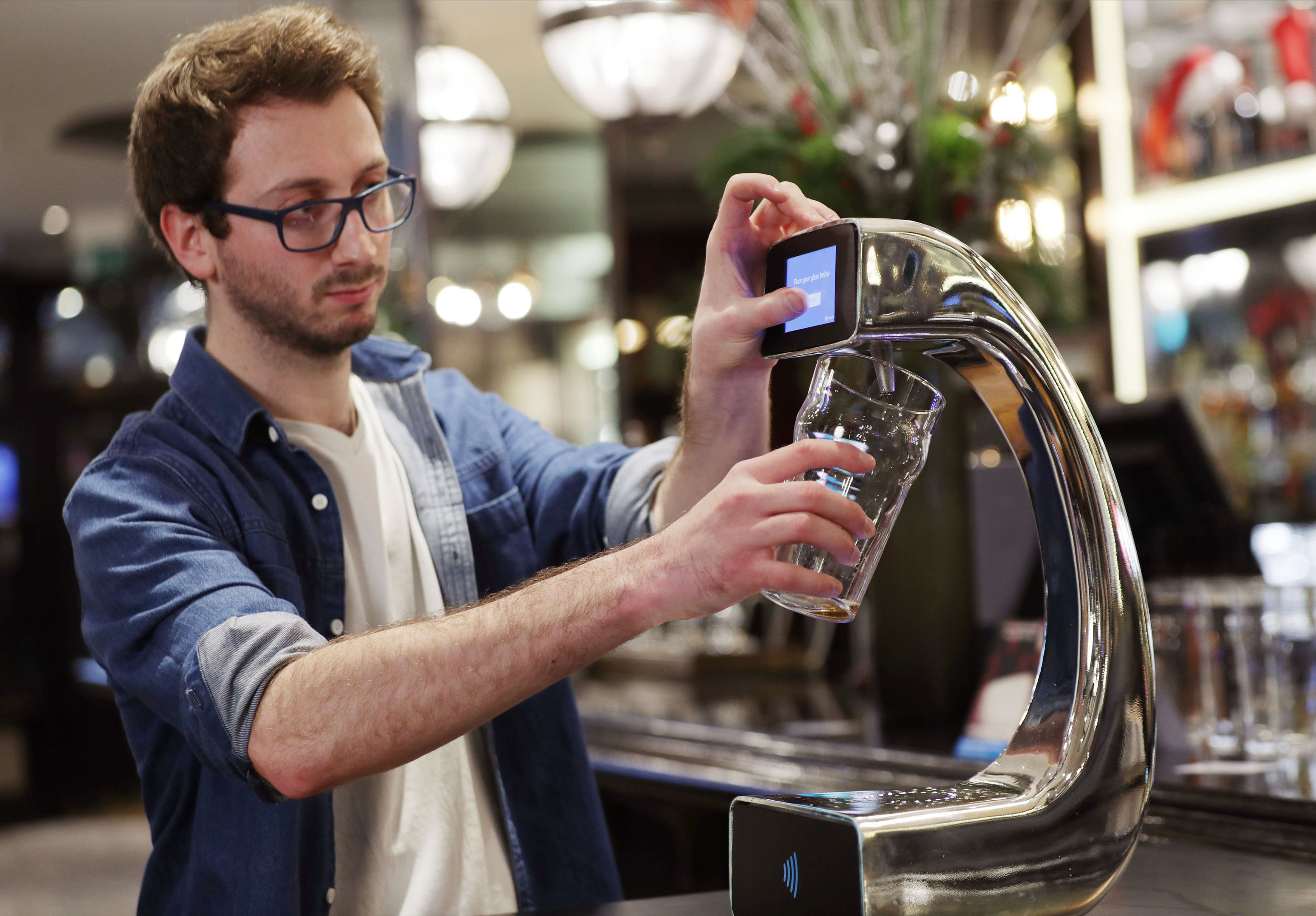 James Miller, who helped to develop  the world's first contactless, self-serving beer pump (Yui Mok/PA Wire)