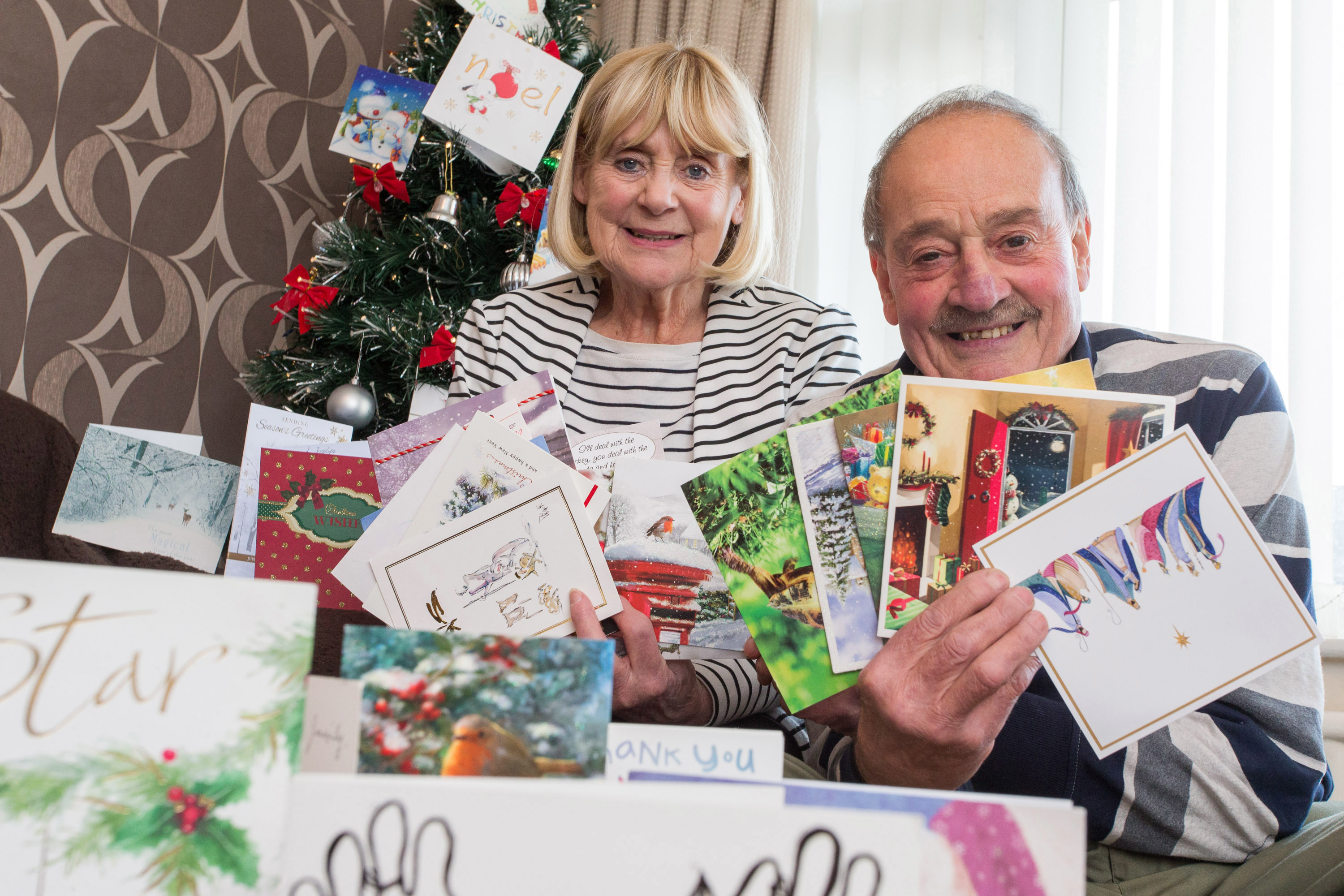 Jos and George Hindle with some of the Christmas cards they receive from the children they have fostered over the years (Bob Collier Photos)