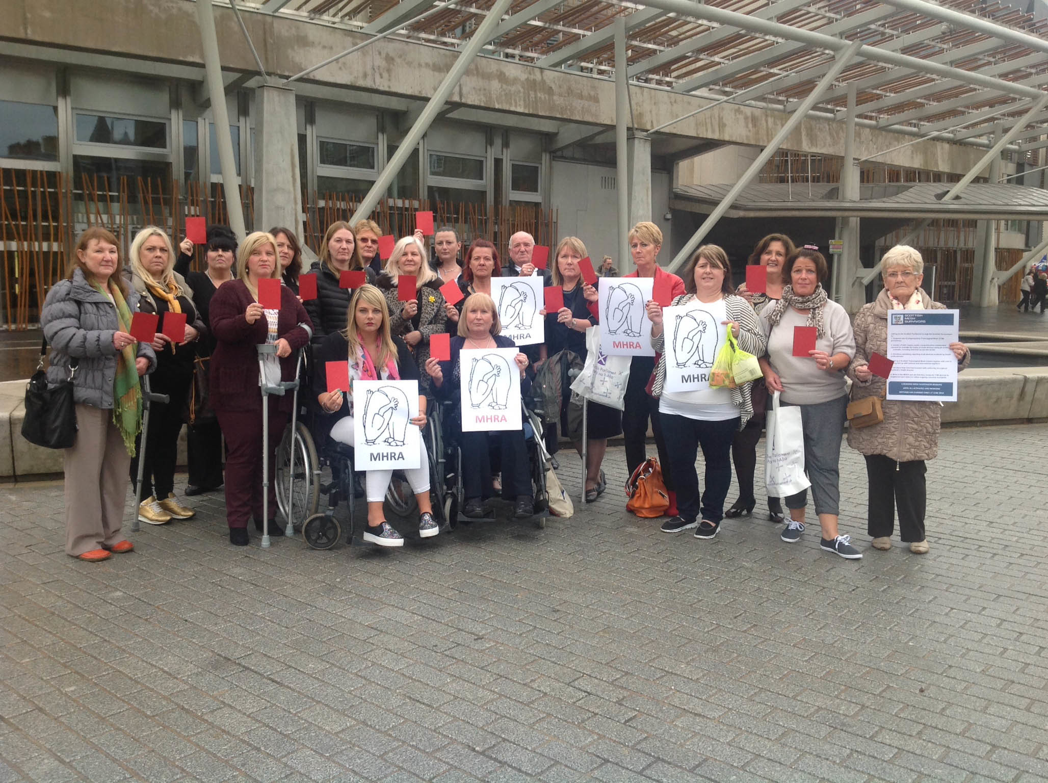 A group of campaigners lobbying against the use of mesh in surgical operations at the Scottish Parliament