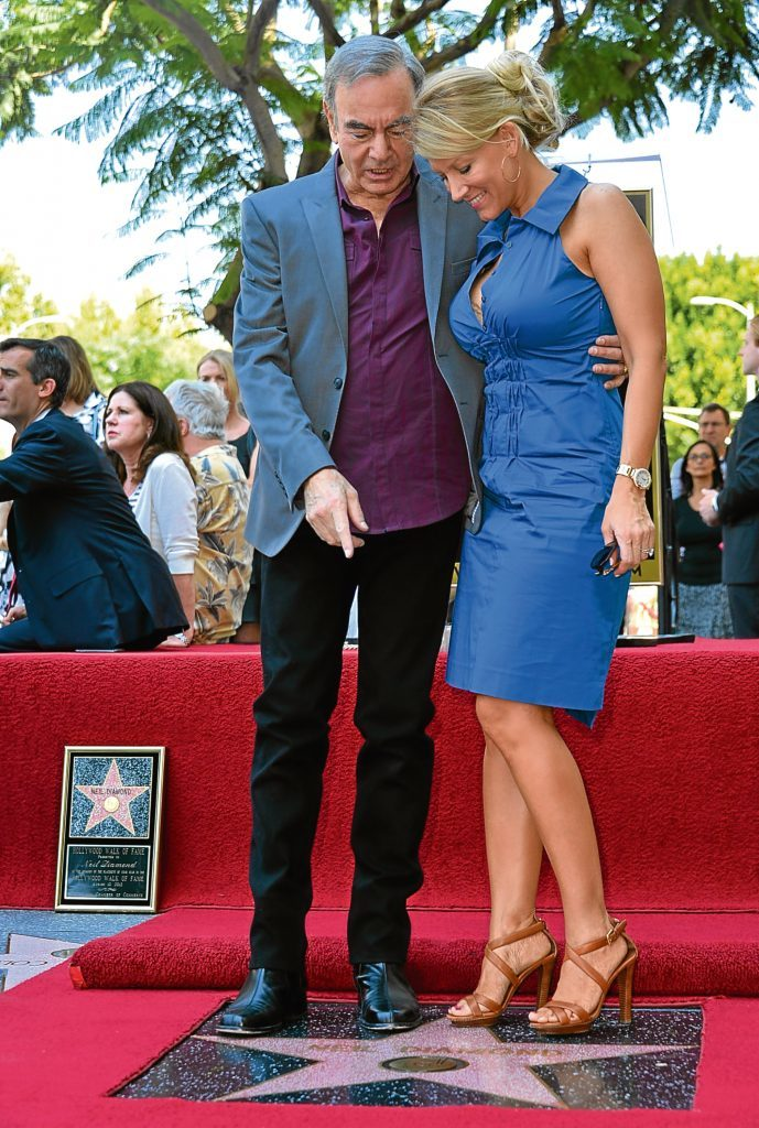 Neil and wife Katie McNeil  (Alberto E. Rodriguez/Getty Images)