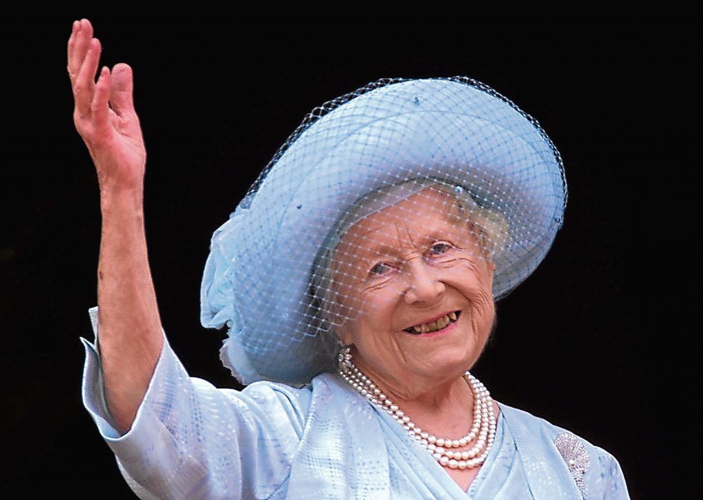 Queen Elizabeth, the Queen Mother celebrates her 100th birthday from the balcony of Buckingham Palace.