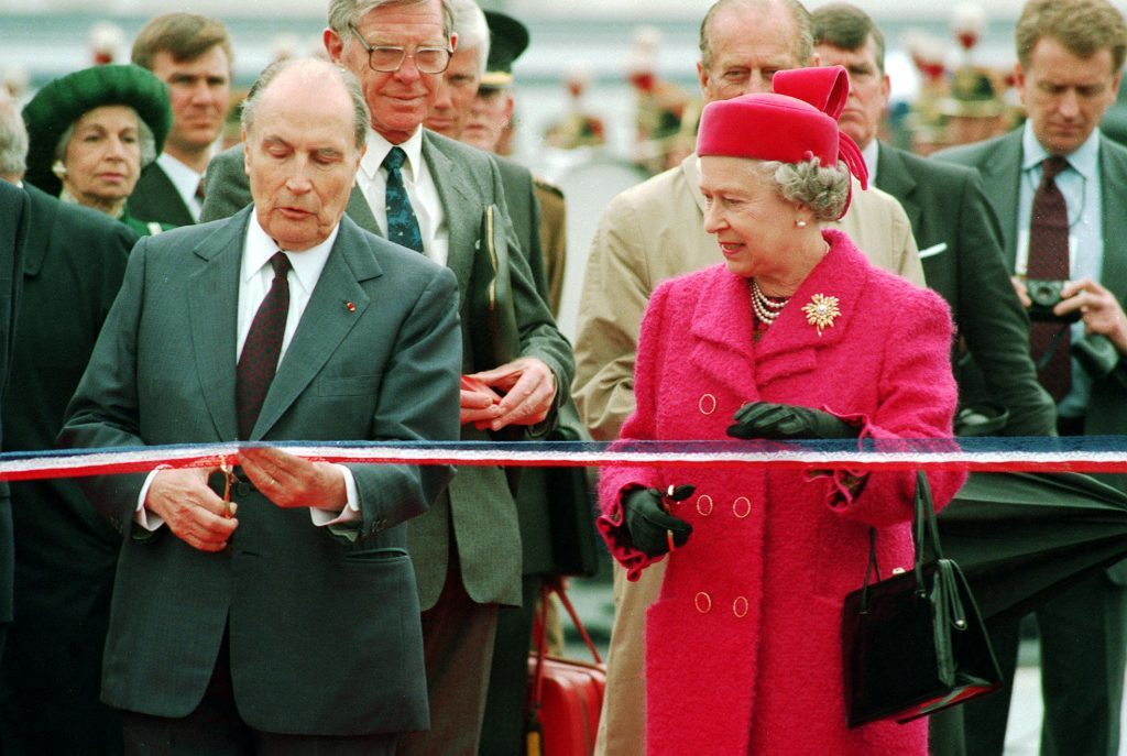 French President Francois Mitterand and the Queen prepare to cut the ribbon at the new terminal for the Channel Tunnel at Coquelles, France.