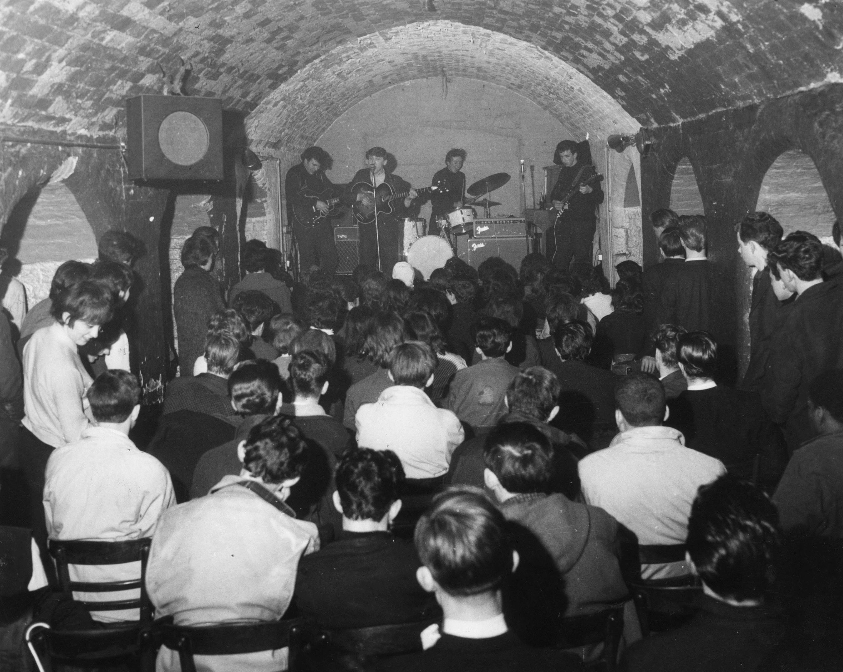 The Merseybeats - named after the musical movement headed by The Beatles - play to a packed Cavern Club audience (Getty Images)
