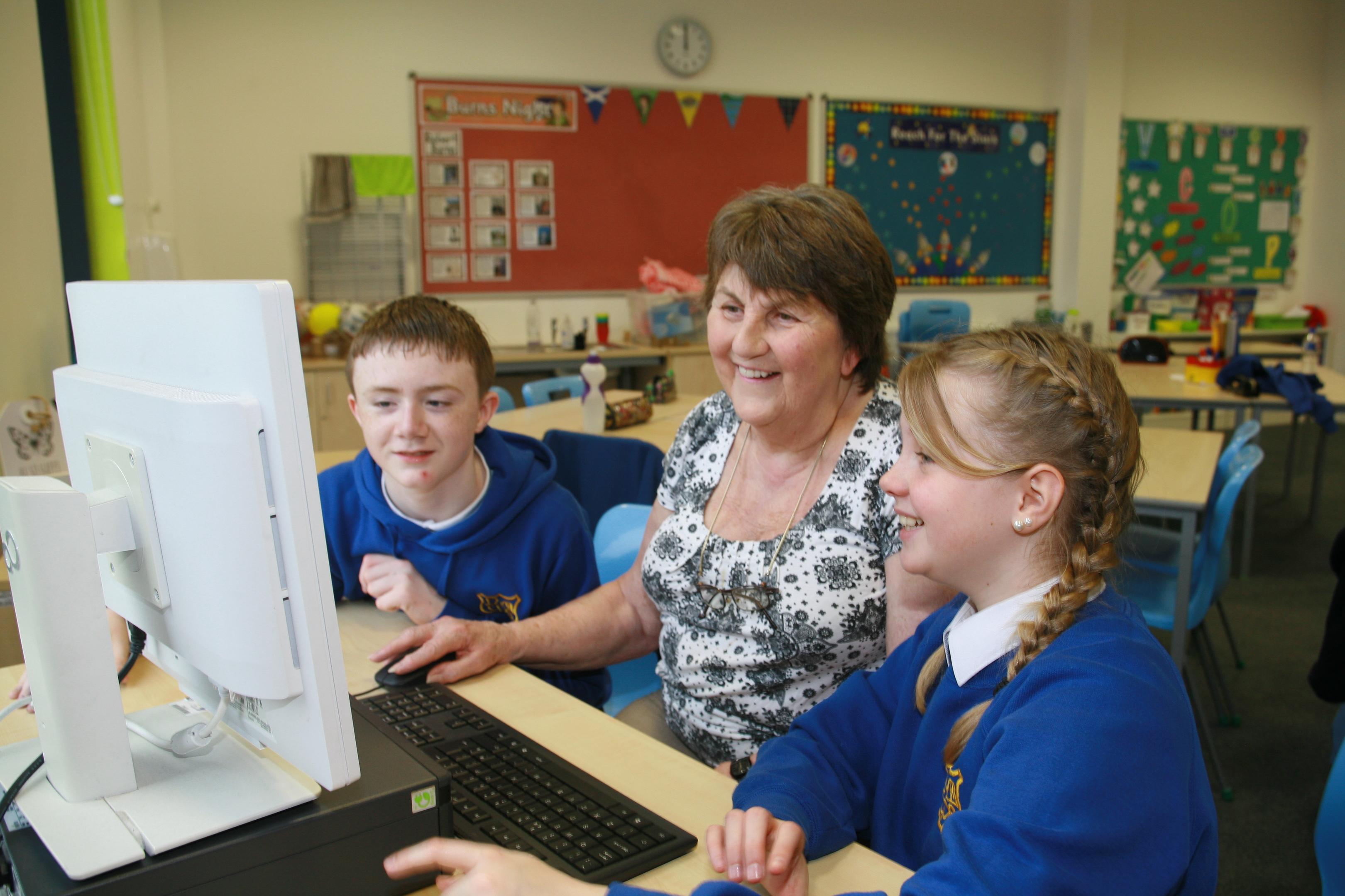 Anne Ferguson gets a helping hand from Aidan Fordham and Faith Easson