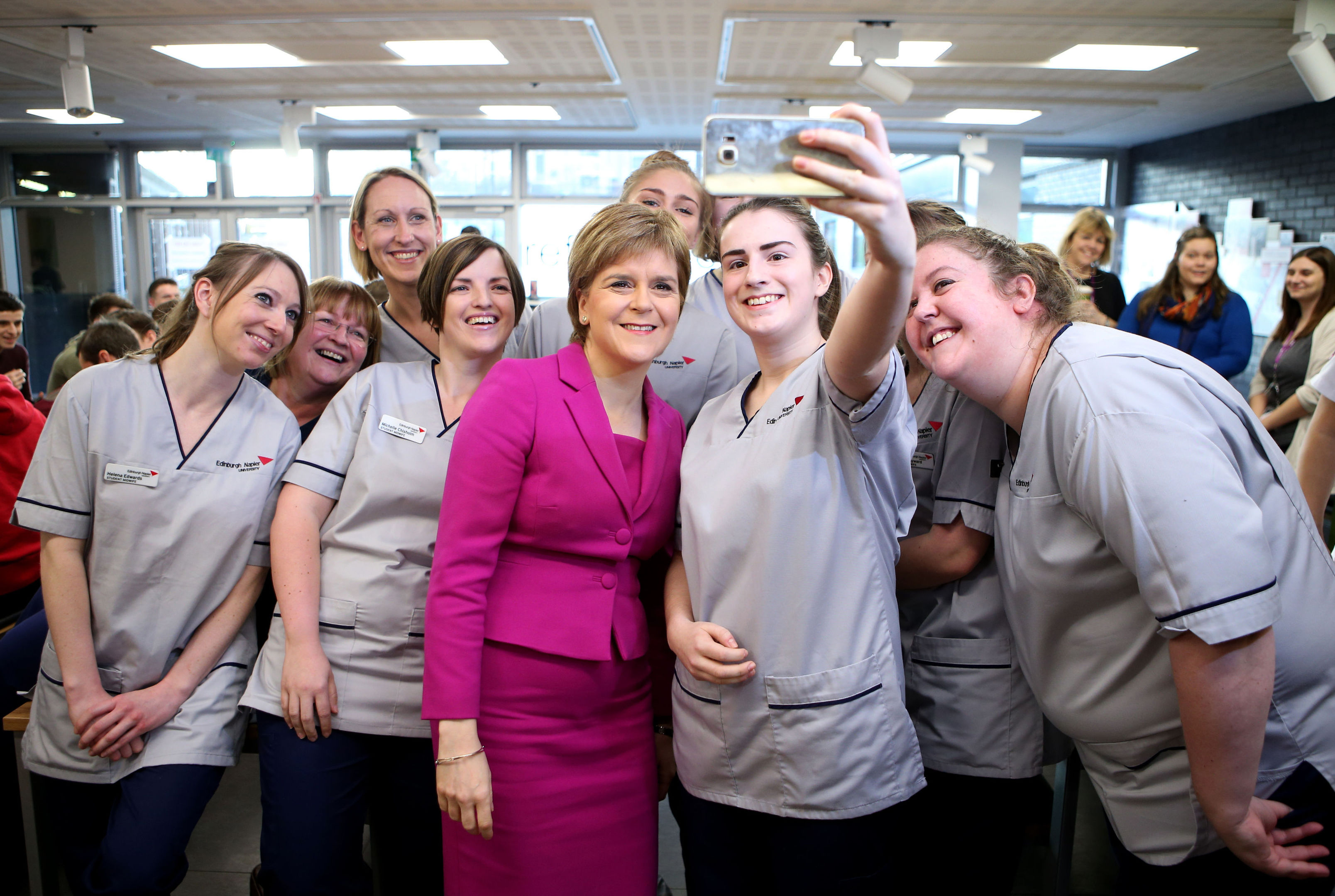 First Minister Nicola Sturgeon poses for a selfie with nursing and midwifery students during a visit to Edinburgh Napier University. (Jane Barlow/PA Wire)