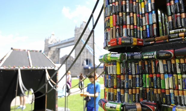A sculpture of Tower Bridge made out of 83,000 recycled batteries (PA)