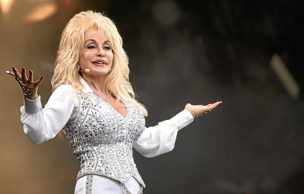 Dolly Parton performs on the Pyramid Stage during Day 3 of the Glastonbury Festival (Photo by Ian Gavan/Getty Images)