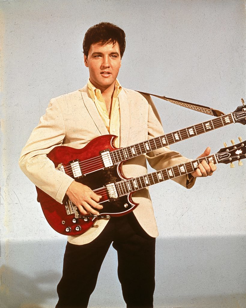 Elvis with a twelve string guitar, mid 1950s (Hulton Archive/Getty Images)