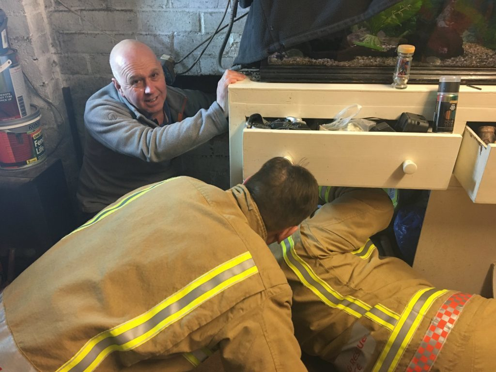 BEST QUALITY AVAILABLE Undated handout photo issued by the RSPCA of emergency services rescuing Mickey the cat, who became wedged in an 8in (20cm) gap between two walls and was freed after a four-hour rescue operation. PRESS ASSOCIATION Photo. Issue date: Tuesday February 7, 2017. Fire crews were forced to cut through a cabinet and use a chisel to cut away bricks before pushing the animal, named Mickey, to safety at a home in Trentham, Stoke-on-Trent. See PA story ANIMALS Wall. Photo credit should read: RSPCA/PA Wire NOTE TO EDITORS: This handout photo may only be used in for editorial reporting purposes for the contemporaneous illustration of events, things or the people in the image or facts mentioned in the caption. Reuse of the picture may require further permission from the copyright holder.