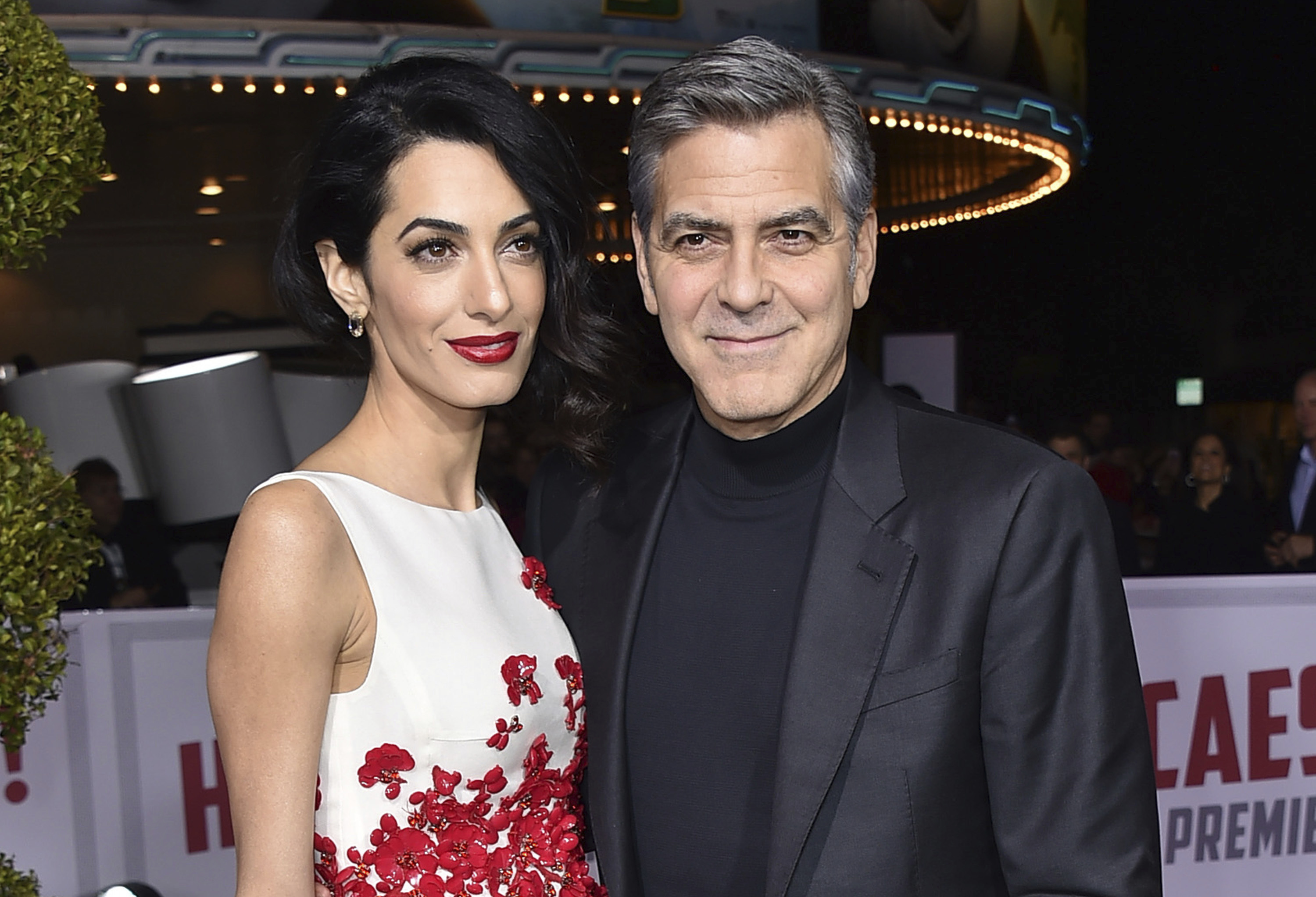 "The Clooneys are expecting twins in June, Julie Chen said Thursday on CBS' ""The Talk.""(Jordan Strauss/Invision/AP, File)"