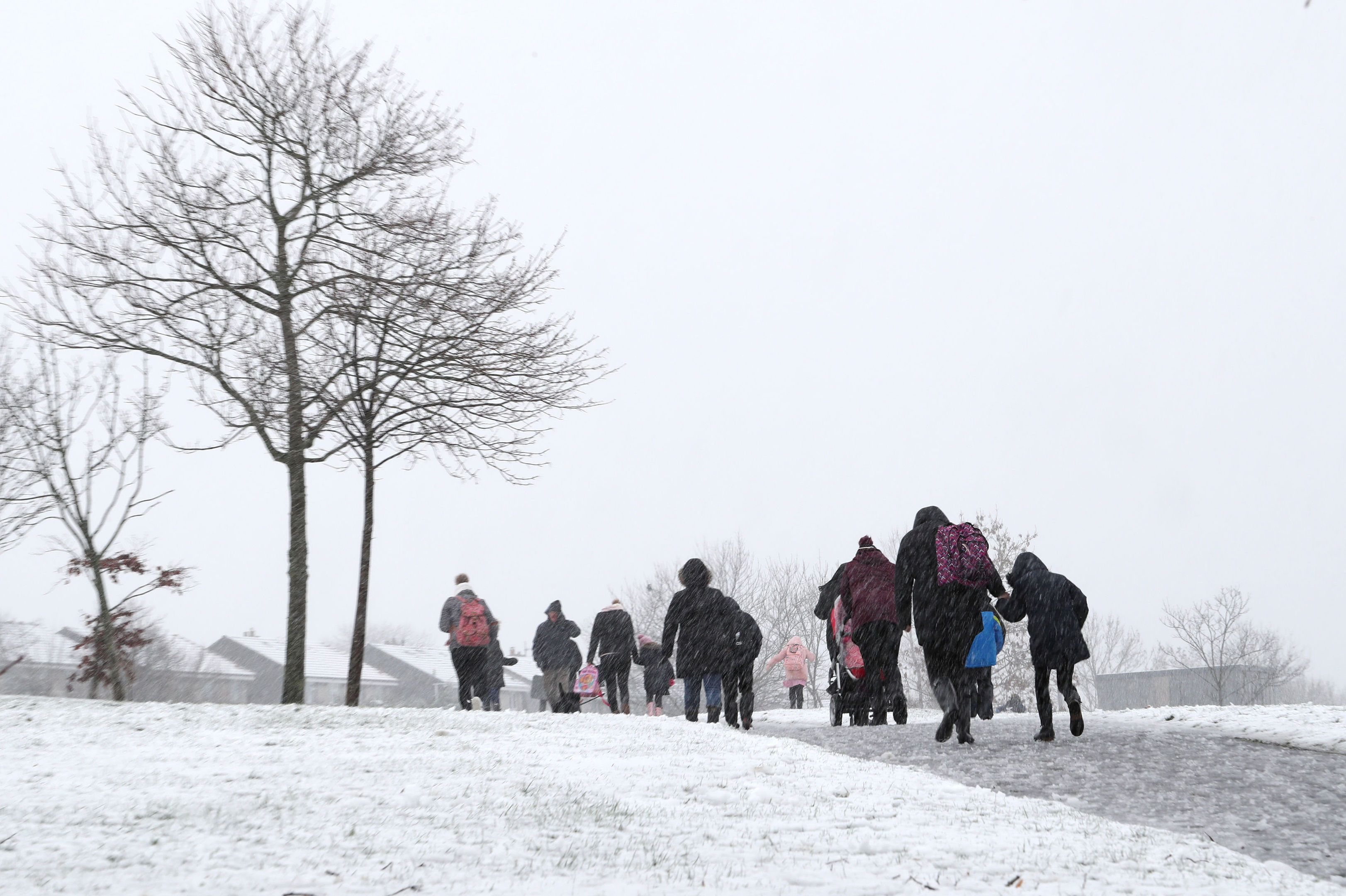 People make their way through the snow in Mauricewood Park in Penicuik, Midlothian, as flights have been cancelled and commuters were warned they faced delays after Storm Doris reached nearly 90mph (Jane Barlow/PA Wire)