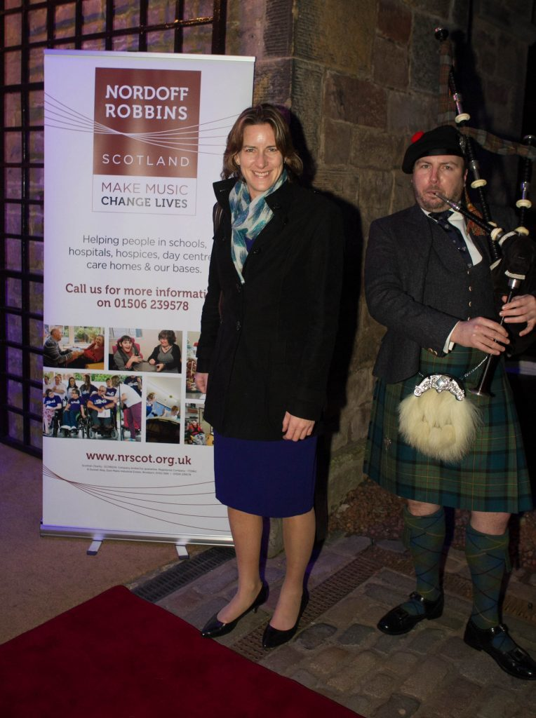 Dame Katherine Granger poses with the piper (Chris Austin / DC Thomson)