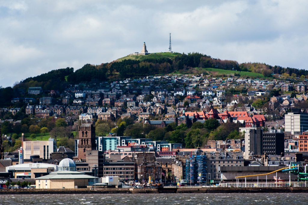 Skyline view of Dundee waterfront - view of the waterfront, and the former Olympia Swimming Pool, Discovery Point and The Law in Dundee, from Fife. (iStock)