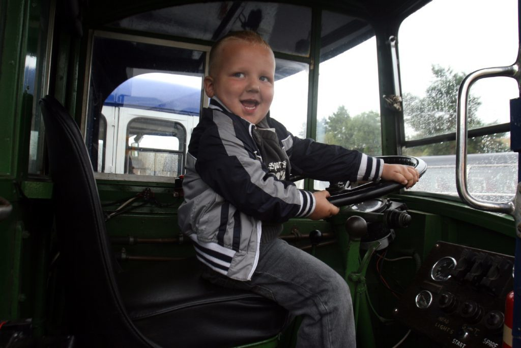 The Scottish Vintage Bus Museum. Three-year-old Toby Brown enjoys the day despite the weather.