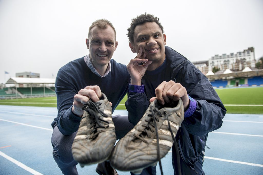 Former Scotland rugby captain Alastair Kellock and Alex Cuthbertson , to whom he donated his old training boots (Wattie Cheung)