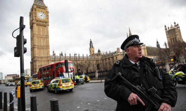 An armed police officer stands guard near Westminster Bridge (Jack Taylor/Getty Images)