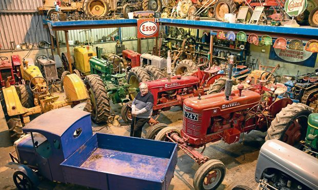 David Reid with his collection of Tractors (Ross Johnston/Newsline Media)