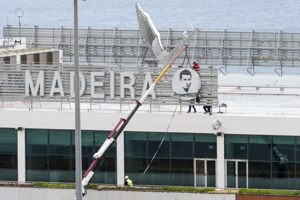 FUNCHAL, MADEIRA, PORTUGAL - MARCH 24: Workers began the renaming works of the Madeira International Airport on March 24, 2017 in Funchal, Madeira, Portugal. Local government have decided to rename the island's main airport after the Madeira-born footballer Cristiano Ronaldo.  The official inauguration ceremony is due to take place on 29 March - the day after a friendly between the country's national team and Sweden in the island's capital, Funchal.  (Photo by Octavio Passos/Getty Images)