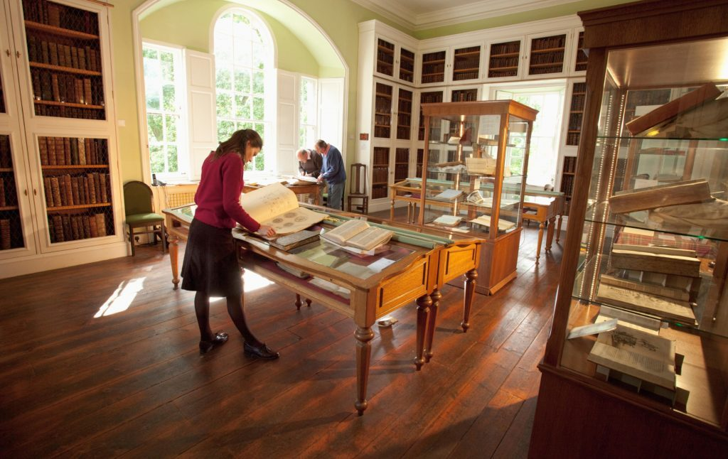Visitors study the various books on display at the Innerpeffray Library - Scotland's first free Public Lending Library, by Crieff