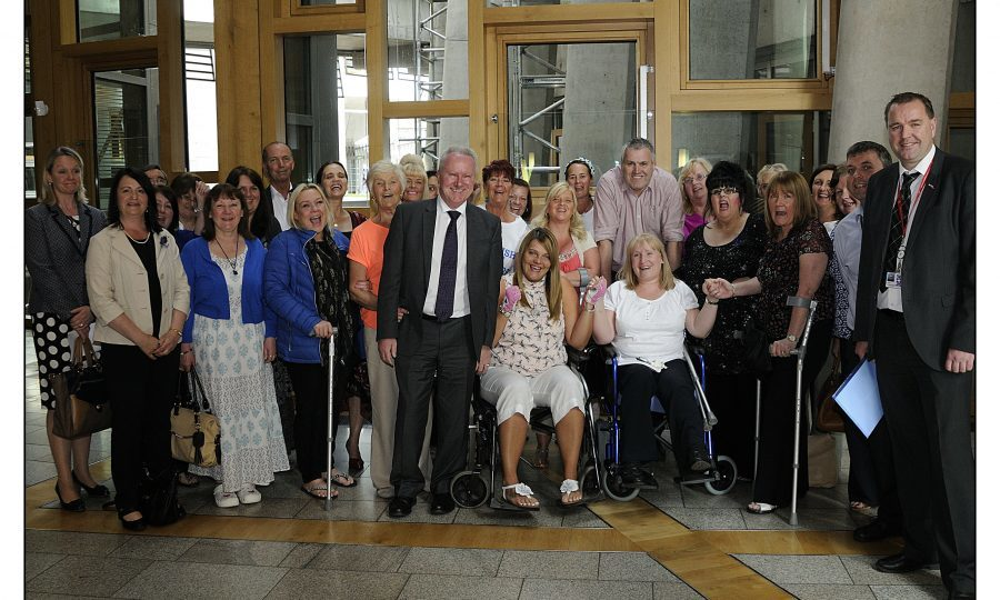 Mesh survivors group with Alex Neil (centre) and Neil Findlay MSP (Pic: Callum Moffat)