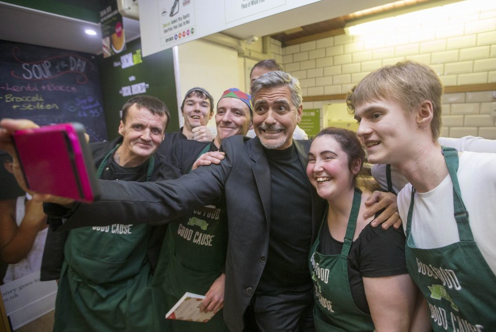 George Clooney taking a selfie with staff as he visits Social Bite (PA)