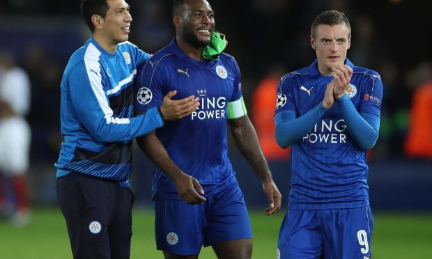 Leicester City's Leonardo Ulloa, Wes Morgan and Jamie Vardy celebrate after the final whistle during the UEFA Champions League, Round of 16, Second Leg match at the King Power Stadium, Leicester. (PA)