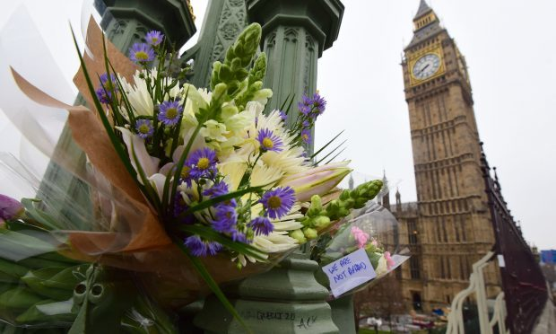 Flowers left on Westminster Bridge (Lauren Hurley/PA Wire)