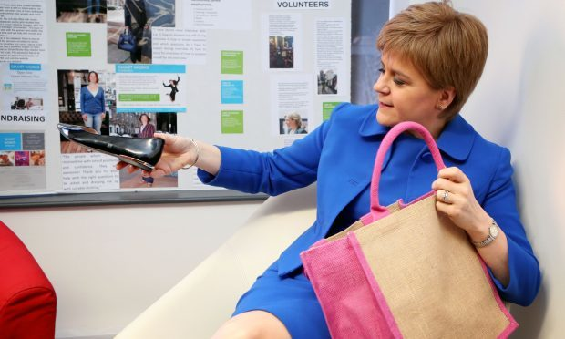 First Minister Nicola Sturgeon donates a pair of shoes to Smart Works in Edinburgh during an event to mark International Women's Day. (Jane Barlow/PA Wire)
