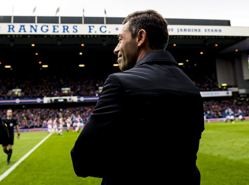 Rangers manager Pedro Caixinha steps onto the park before the match (SNS Group)