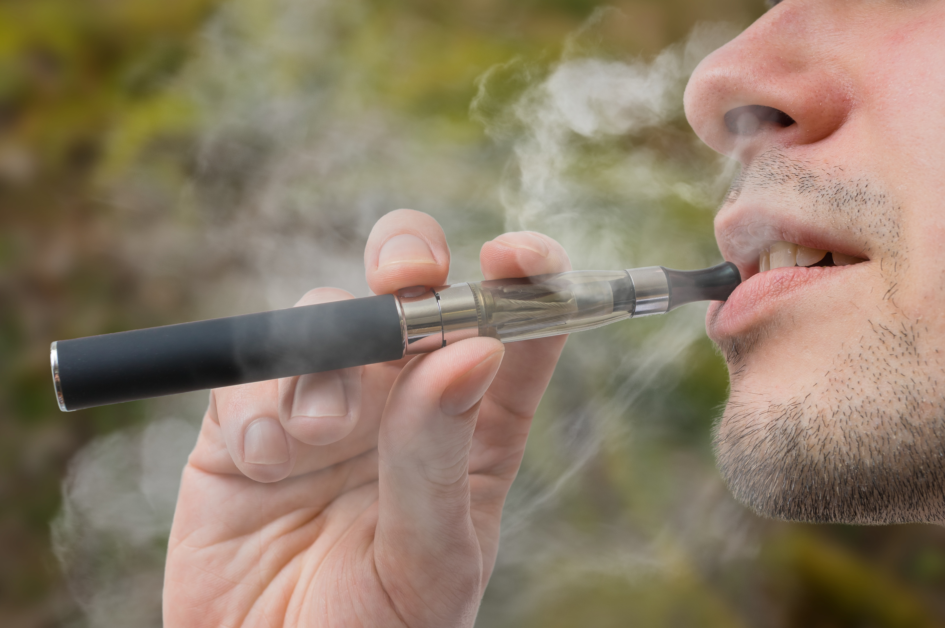Holy e-smoke! Experts say vaping can help 'cure' sore