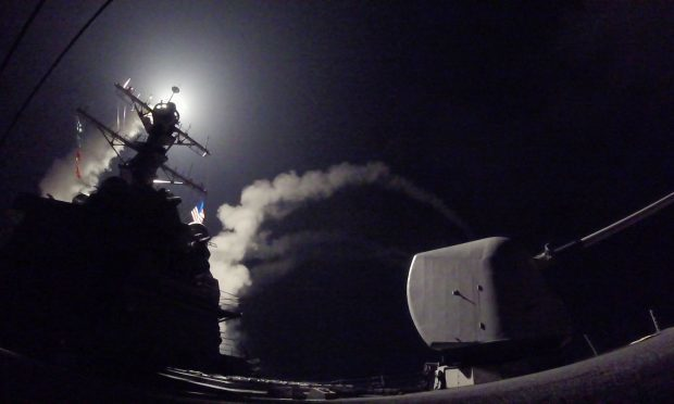 USS Porter (DDG 78) launches a tomahawk land attack missile in the Mediterranean Sea(Mass Communication Specialist 3rd Class Ford Williams/U.S. Navy via AP)