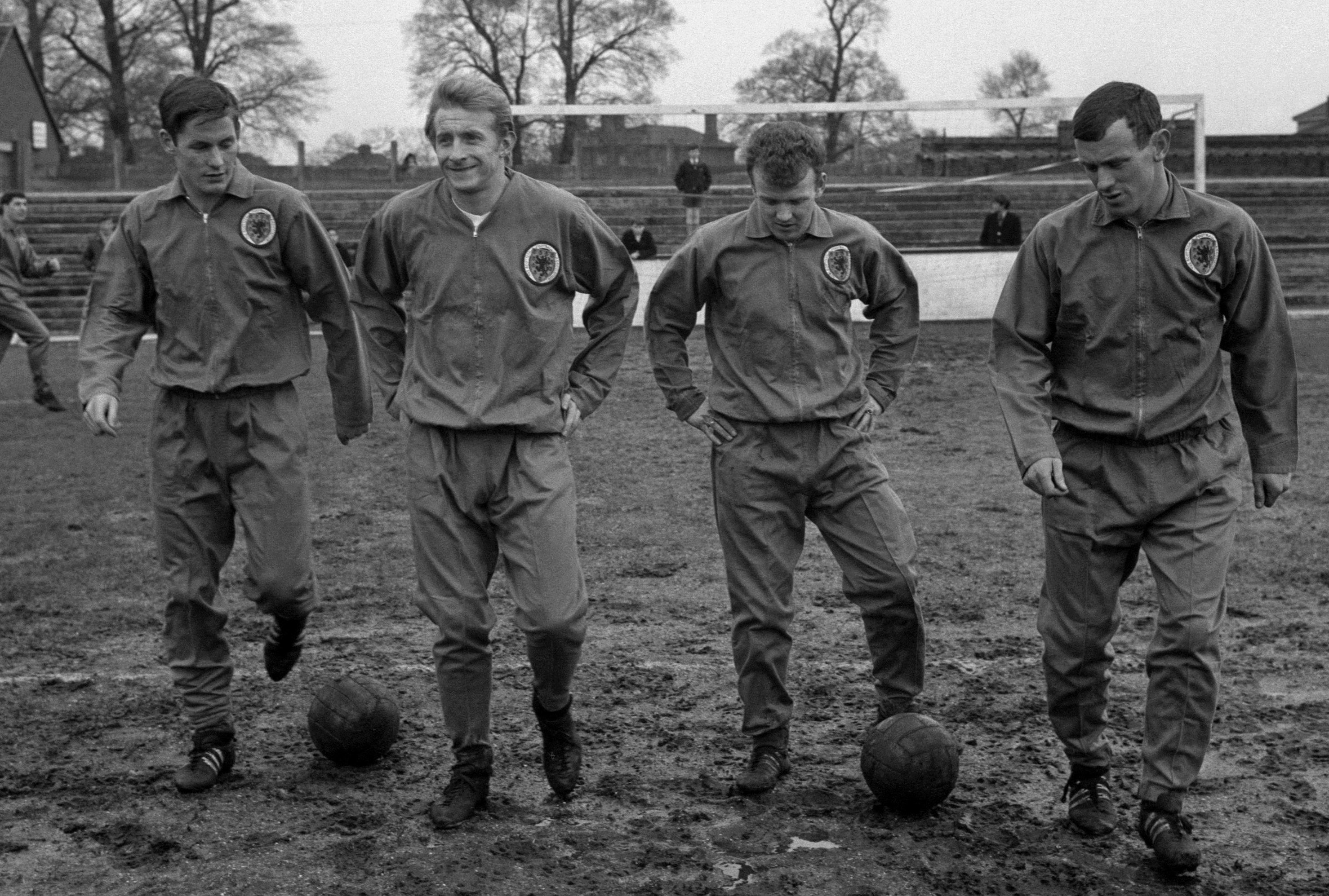 Jim McCalliog, Denis Law, Billy Bremner and Bobby Lennox in training ready for the match against England (PA Wire)