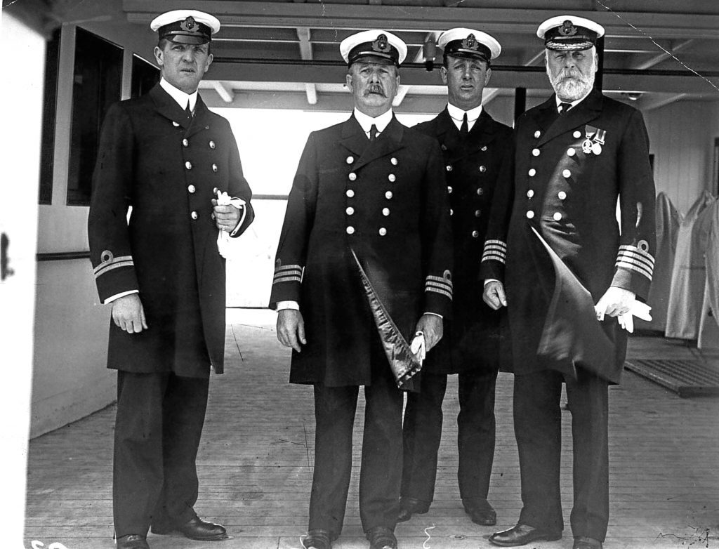 Officers of the White Star liner 'Olympic' including Lieutenant Murdoch (far left) and Captain John Smith (right) later captain of the ill-fated 'Titanic.'  (Topical Press Agency/Getty Images)