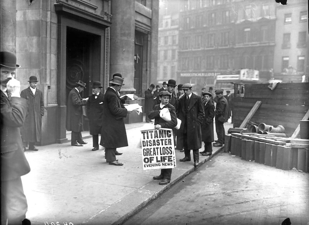 Newspaper boy Ned Parfett sells copies of the Evening News telling of the Titanic maritime disaster outside the White Star Line offices in London (Topical Press Agency/Getty Images)