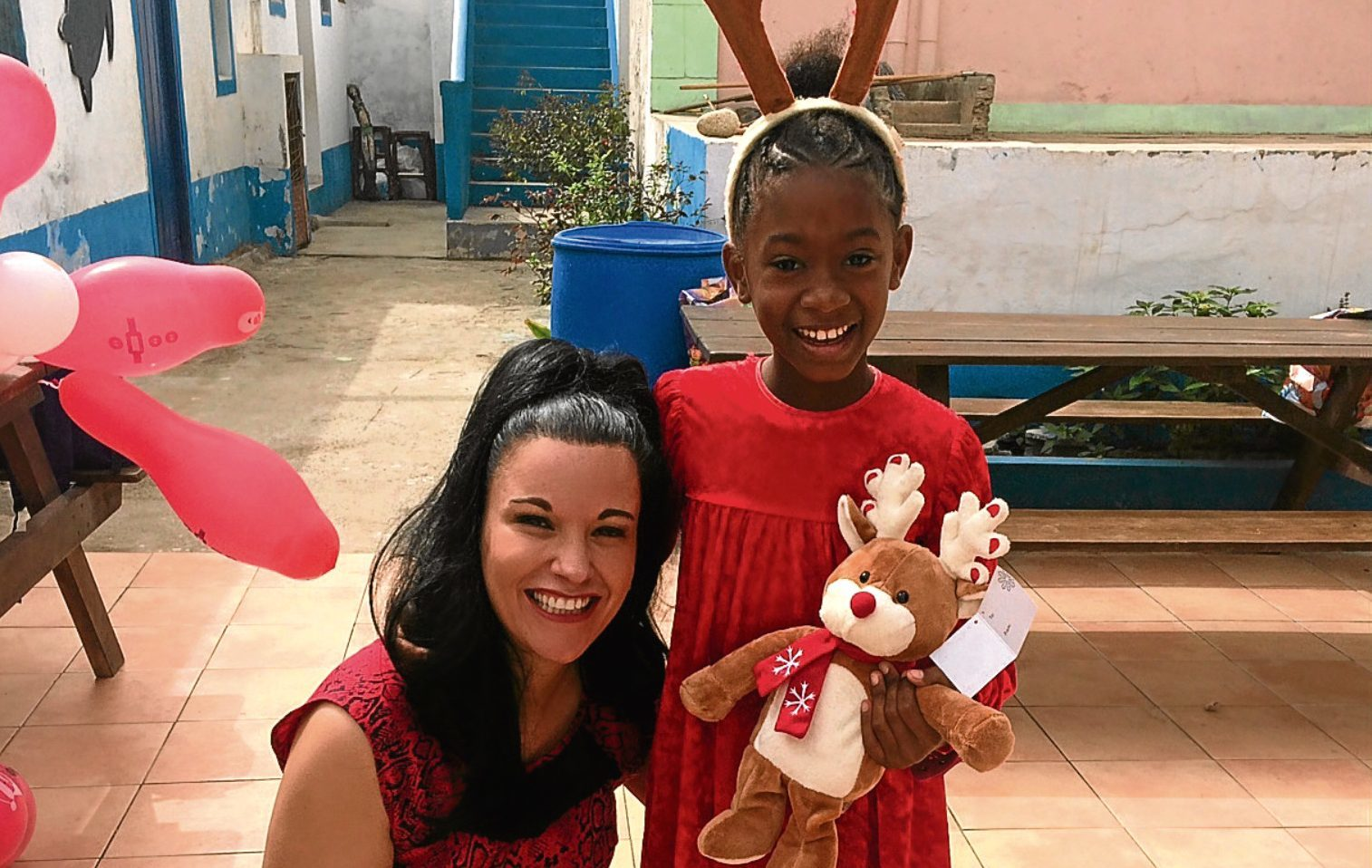Elaine in Cape Verde with one of the kids who benefited from her Christmas campaign.