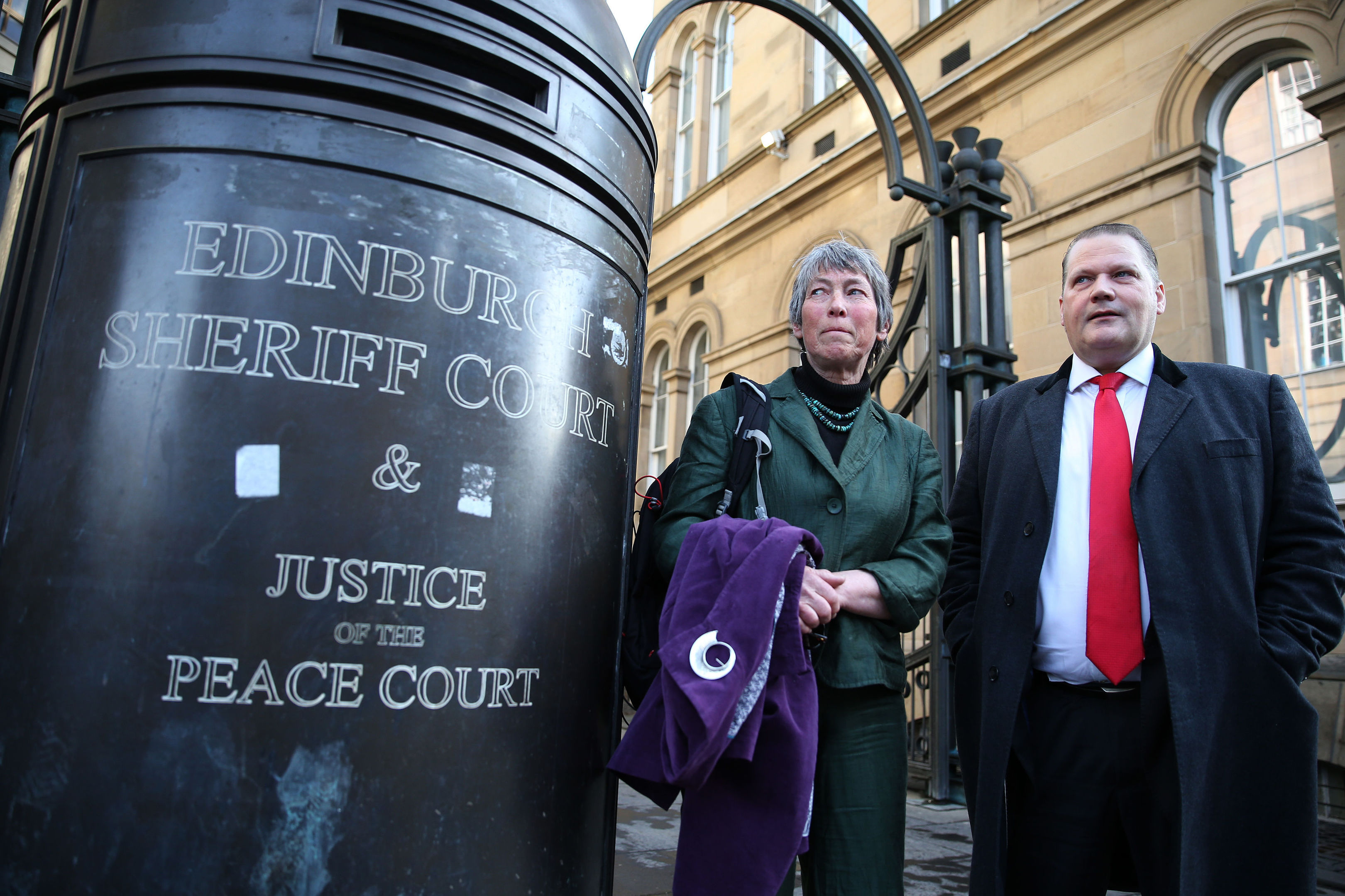 Carol Rohan Beyts, with her lawyer lawyer Mike Dailly outside Edinburgh Sheriff Court, who has been permitted to pursue damages against Donald Trump's Aberdeenshire golf course over allegations that staff filmed her urinating. (Andrew Milligan/PA Wire)