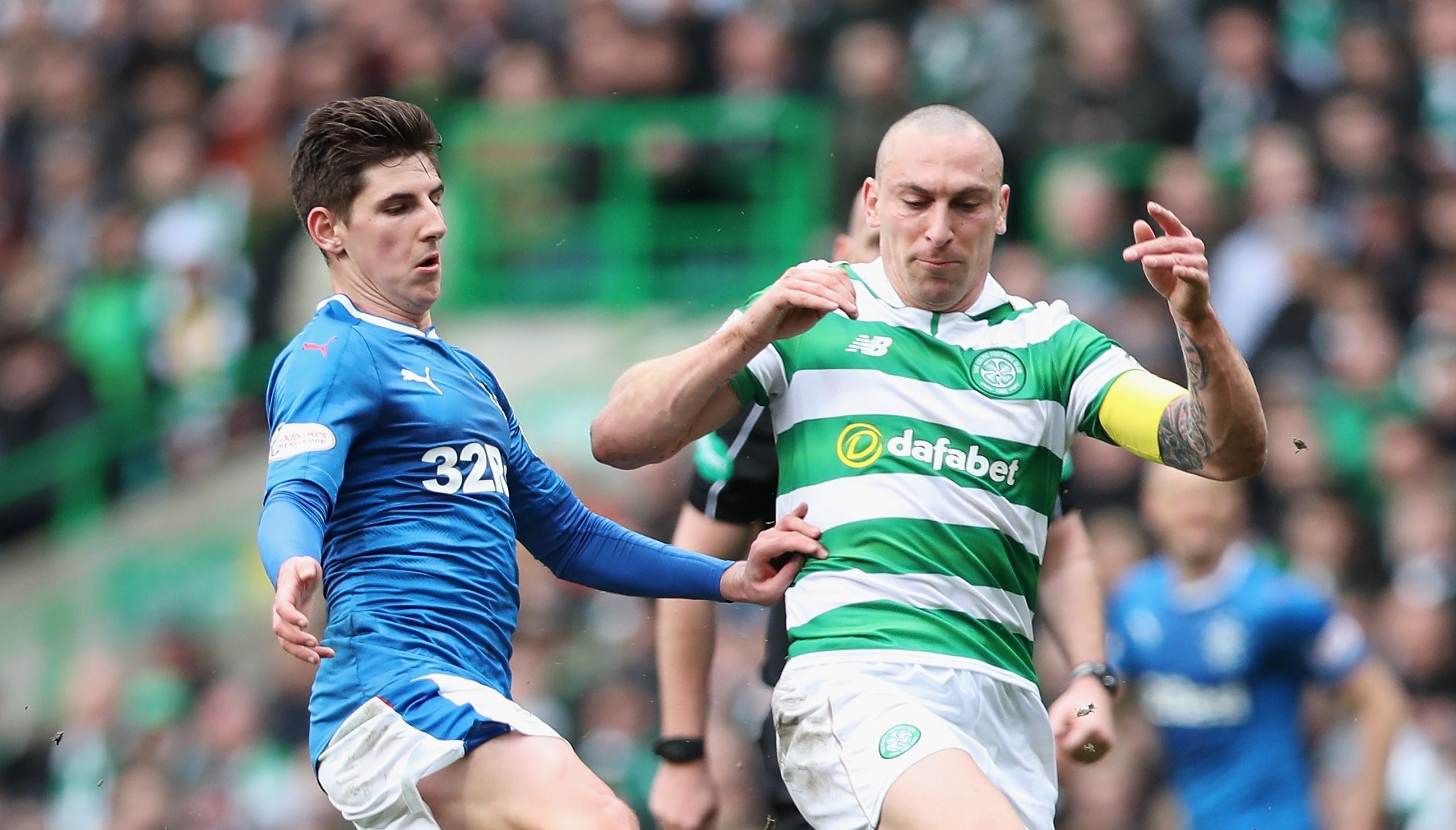Emerson Hyndman of Rangers (L) and Scott Brown of Celtic (R) battle for possession (Ian MacNicol/Getty Images)