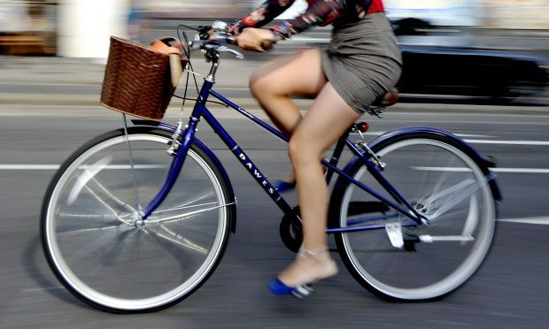 Research suggests that cycling to work cuts the risk of developing heart disease and cancer by almost half. (Tim Ireland/PA Wire)