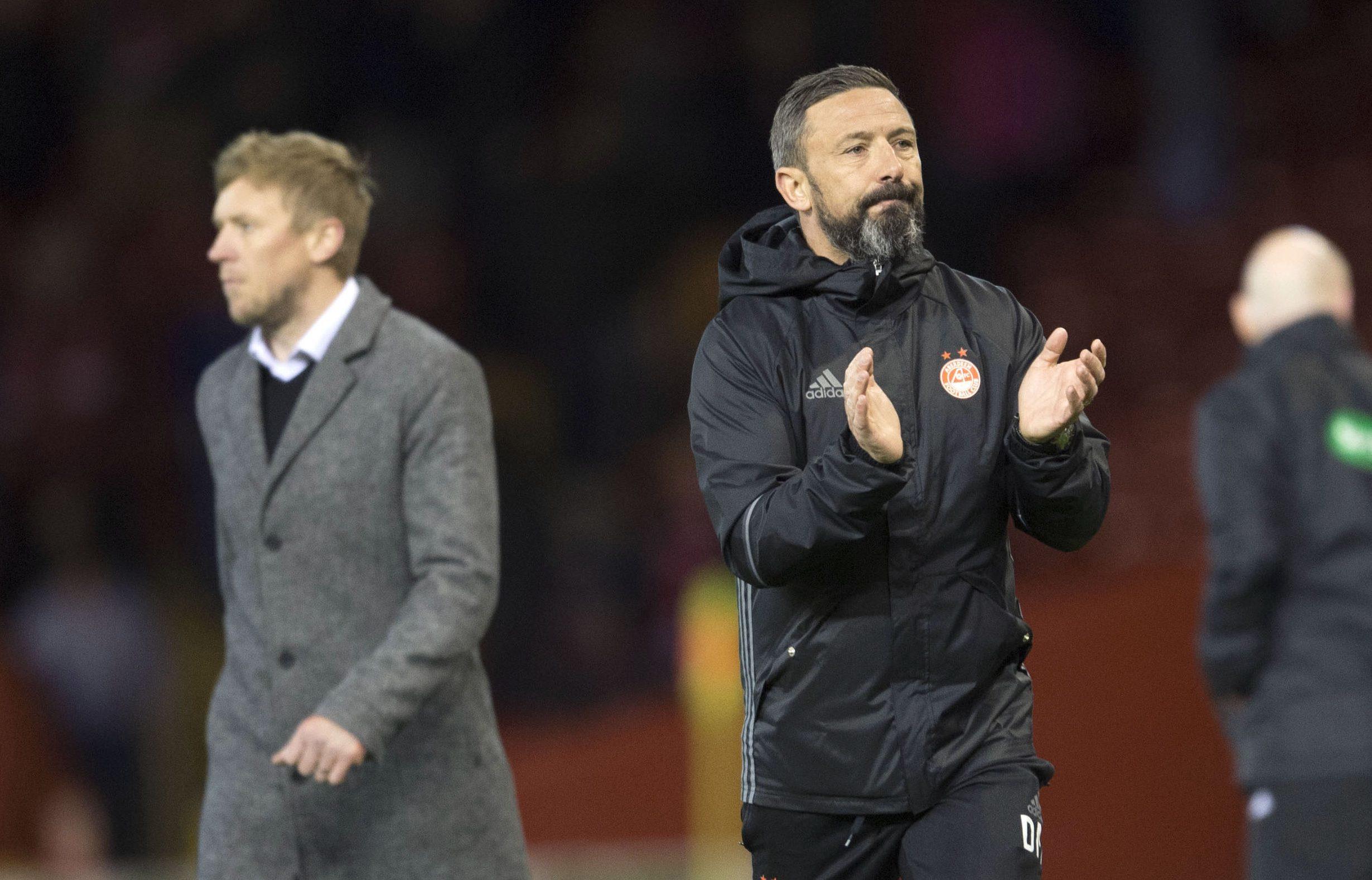 Aberdeen manager Derek McInnes applauds the fans at full time (SNS Group / Bill Murray)